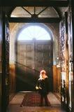 Girl entering church Stock Image
