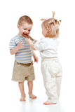 Girl entertaining boy by chocolate Stock Photo