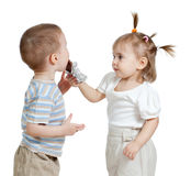 Girl entertaining boy by chocolate Stock Images
