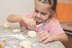 Girl with enthusiasm floured pastry stuck together Royalty Free Stock Photo