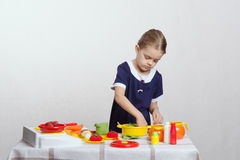 Girl enthusiastically picks pan in the kitchen Stock Images