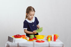Girl enthusiastically prepares soup Royalty Free Stock Photo