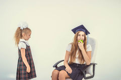 The girl envies the other eats Stock Photography