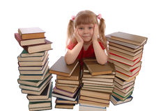 The girl in an environment of books. On a white background Royalty Free Stock Photography
