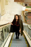 Girl on escalator Royalty Free Stock Photo