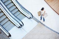 Girl by escalator Stock Photography