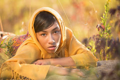 Girl escaping. A girl dressed in a yellow hijab escapes for her life Royalty Free Stock Photo