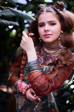 Girl in ethnic clothes in tropical garden with snake Royalty Free Stock Photos