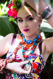 Girl in ethnic clothes in tropical garden with snake Royalty Free Stock Photography