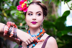 Girl in ethnic clothes in tropical garden with snake Royalty Free Stock Image
