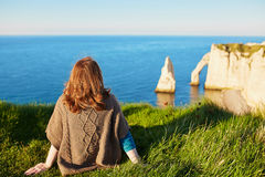Girl in Etretat, sitting on top of hill Stock Photography