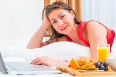 Girl of European appearance with a laptop Stock Images