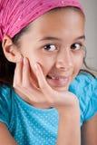 Girl of European and Asian parentage. Beautiful girl of European and Asian parentage with pink bandanna Stock Image