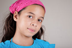 Girl of European and Asian parentage with pink ban Stock Photo