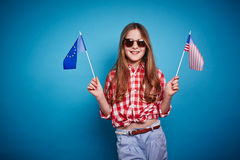 Girl with European Union and American flags Royalty Free Stock Photos