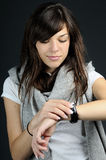 Girl evaluating time. Worried young woman analyzing time Royalty Free Stock Images