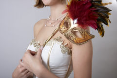 Girl in evening dress with a carnival mask Royalty Free Stock Photo