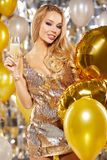 Girl in evening dress with champagne glasses - new year, celebra Stock Image