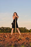 Girl in evening dress dug field Royalty Free Stock Images