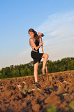 Girl in evening dress dug field Royalty Free Stock Photos