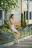 The girl in an evening dress goes down the street 3365. Royalty Free Stock Image