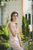 The girl in an evening dress goes down the street 3366. Stock Photos