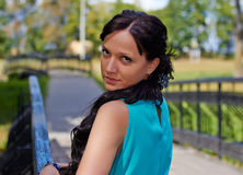 Girl in evening dress in the Park. Girl in evening dress on the bridge in the Park Royalty Free Stock Photography