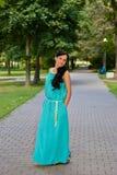 Girl in evening dress in the Park. Full length Stock Photo