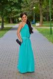 Girl in evening dress in the Park. Full length Stock Image