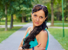 Girl in evening dress in the Park. Looking at camera Royalty Free Stock Photo