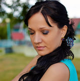 Girl in evening dress in the Park. Girl in evening dress with my eyes closed Stock Photography