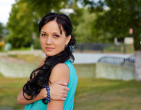 Girl in evening dress in the Park. Girl in evening dress, near the road Stock Photography