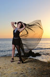 The girl in an evening dress on the seashore Royalty Free Stock Photo