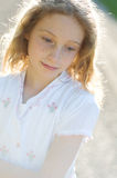 Girl in evening light. Young girl back lit by evening sun Stock Photo