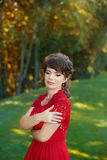 Girl in evening red dress Stock Photography