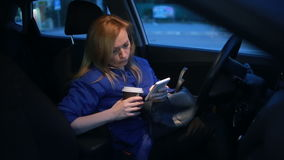 Girl in the evening talking on the phone while sitting in the car stock video footage