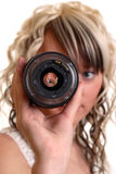 Girl examine lense. Girl examine photo lense, focus on eye in lense Royalty Free Stock Image