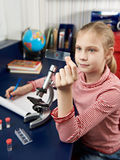 Girl examines drug for the microscope Stock Image