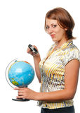 Girl examines the globe Stock Photo