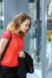 Girl examines shop windows Royalty Free Stock Photos