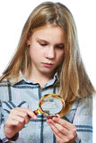 Girl examines silver collection coins isolated. White stock photography