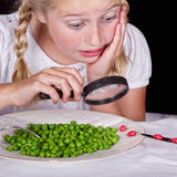Girl examining bugs on table with magnifying glass Royalty Free Stock Photos