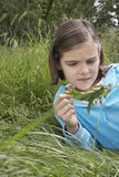 Girl Examining Caterpillar On Leaf Royalty Free Stock Photos