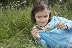 Girl Examining Caterpillar On Leaf Royalty Free Stock Photo