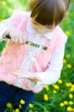 Girl examining hand using magnifying glass Royalty Free Stock Photography