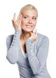 Girl examining her face Stock Photo