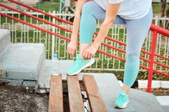 Active girl with excess weight is going to go in for sports to lose weight at the stadium. Healthy lifestyle. royalty free stock photo