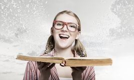 Girl excited with book Stock Image