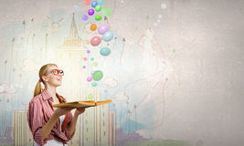 Girl excited with book Royalty Free Stock Images