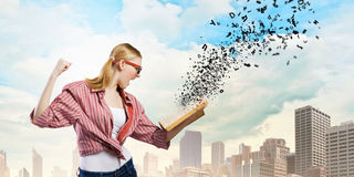 Girl excited with book Stock Photos